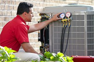 hvac technician repairing and air conditioning unit