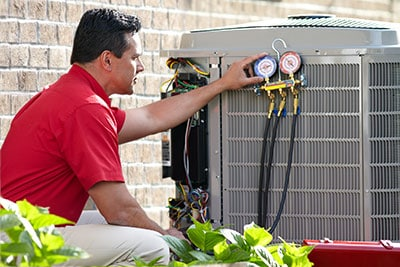 hvac technician repairing and air conditioning unit
